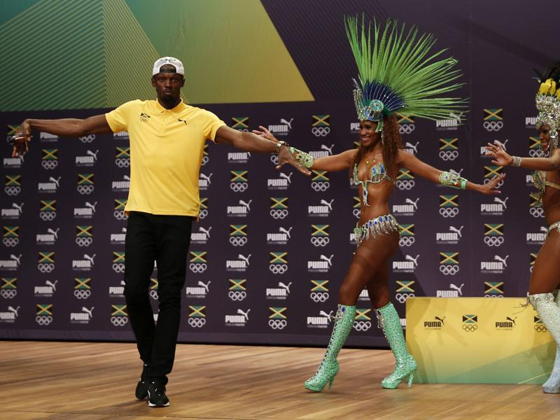 Despite the injury scare, both Bolt, showing his Samba skills here, and Jamaica team management are confident of another big haul of medals in Rio. (AFP Photo)