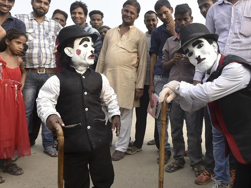 Till some time ago, he had a turf war with another dwarf, Raju (on right), who was also posing in the same garb for photos with tourists. Raju eventually left and now, Monu is the sole Charlie Chaplin of India Gate.  (Raj K Raj/HT PHOTO)