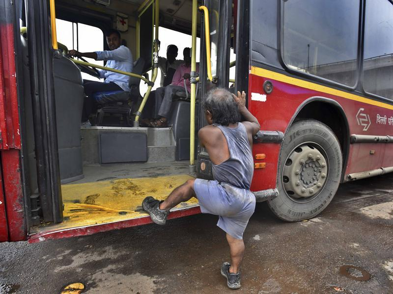 Every morning, Monu boards a DTC bus early on in the day, from the Nizzamuddin bus stand. Public transport, just like  some people, can be unfriendly to Monu.  (Raj K Raj/HT PHOTO)