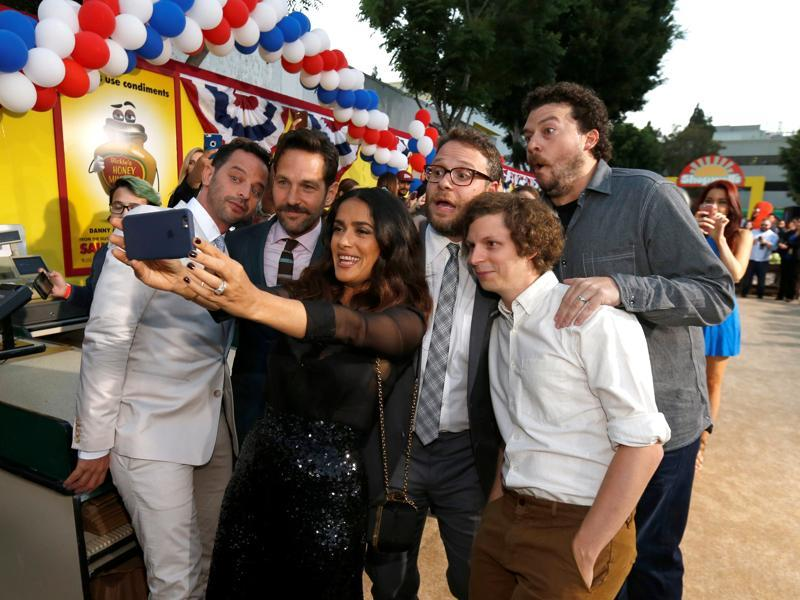 Cast member Salma Hayek takes a selfie with co-stars (L-R) Nick Kroll, Paul Rudd, Seth Rogen, Michael Cera and Danny McBride at the premiere for the movie Sausage Party. (REUTERS)