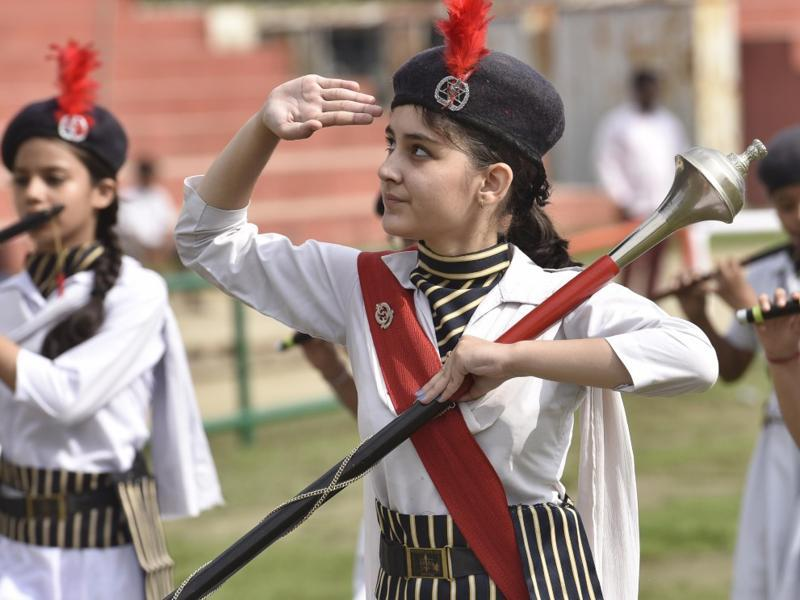A student saluting during parade at the full dress rehearsal for Independence Day celebration in Amritsar on Saturday. (Gurpreet Singh/HT Photo)
