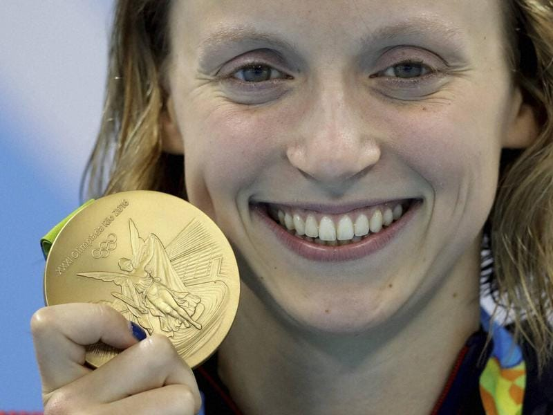 Katie Ledecky of the United States destroyed the field in the 800 metres freestyle on Friday, breaking her own world record to complete a rare Olympic swimming treble.  (AP)