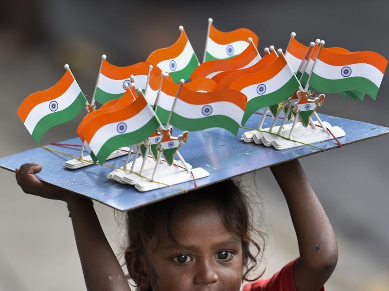 A child sells the national flag at CST in Mumbai. (Kunal Patil/ht photo)