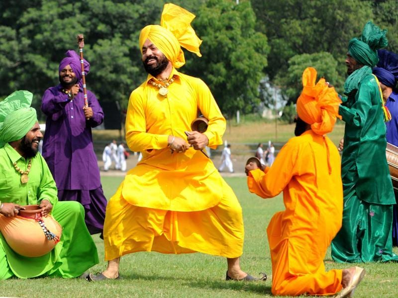 A team of Punjab Police performing Malwai Giddha at YPS Stadium in Patiala on Saturday. (Bharat Bhushan/HT Photo)