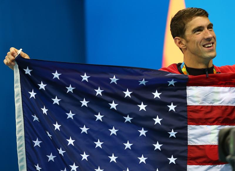 """I walked to the pool tonight and I almost felt myself starting to cry - the last warm-up, the last time putting on a suit, the last time walking out in front of thousands of people representing my country,"" Phelps  said of his final swim in his fifth Olympics. (REUTERS)"