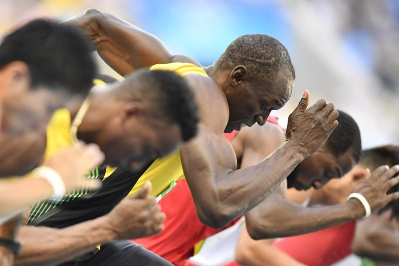 Bolt, the two-time defending Olympic champion , got off the blocks quickly and won his heat  in 10.07 seconds. (AFP)