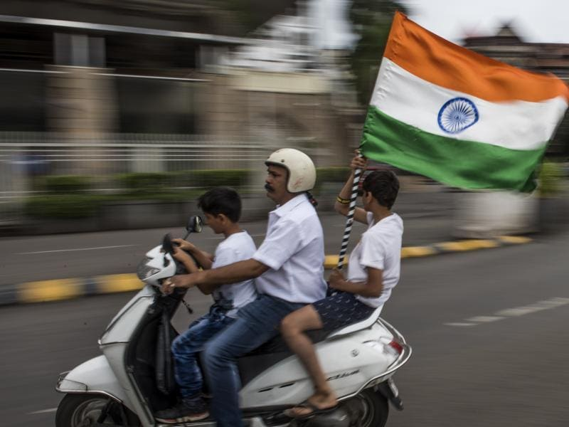 A family celebrates the spirit of independence at the Gateway of India in Mumbai on Monday. (satish bate/ ht photo)
