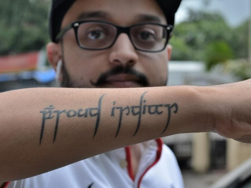 "A man flaunts a tattoo that says ""proud Indian"" at Hiranandani in Powai, Mumbai.  (prashant waydande/ht photo)"