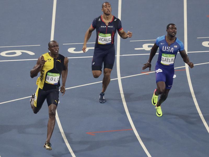 The fastest man  in the world retains his title clocking 9.81 seconds,  0.08 seconds  ahead of Gatlin (right). (AP photo)