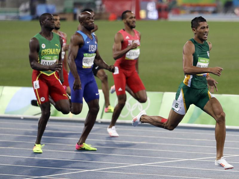 Van Niekerk is the first ever runner to go under 10 seconds for the first 100m, 20 seconds for 200m and 44 seconds for 400m. (AP Photo)