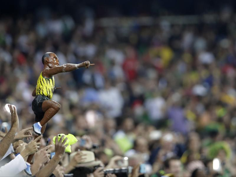 A miniature model of Bolt too was in the crowd to support the great champ. (AP photo)