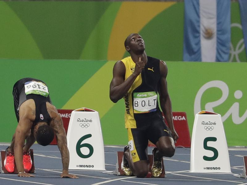 Bolt  at the starting block, praying for a bit of diving grace! (AP photo)