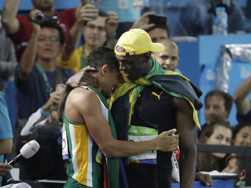 Bolt embraces South Africa's Wayde Van Niekerk, the night's other headline maker, who won the 400 metre gold medal after smashing American Michael Johnson's world record that stood since 1999. (AP photo)