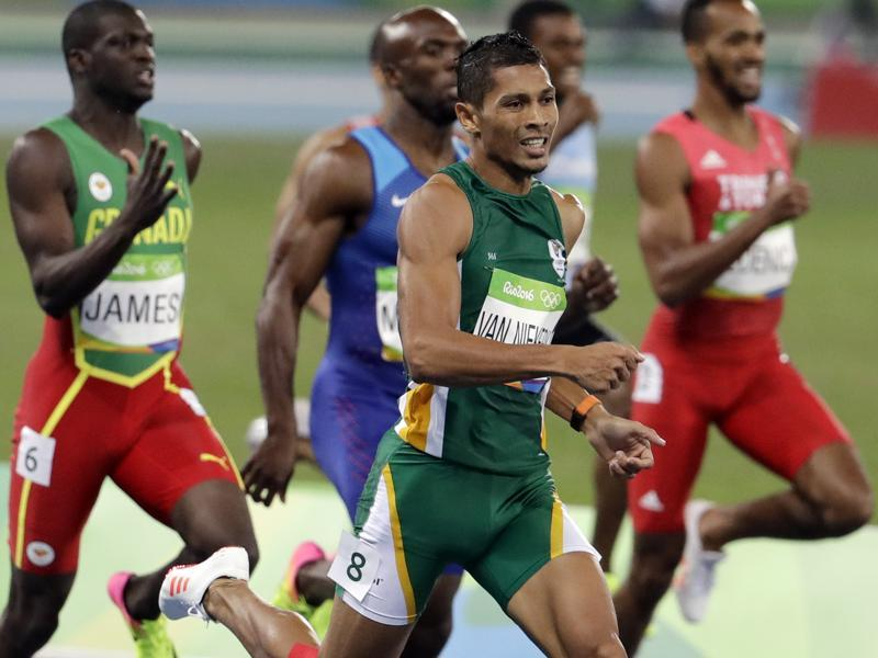 Van Niekerk , from Cape Town, went quickly off the block and it looked as though both Kirani James (left), the London Olympics gold medallist and LaShawn Merritt (US) would eventually reel him in at the bends. But instead, Van Niekerk just kept increasing his lead. (AP Photo)