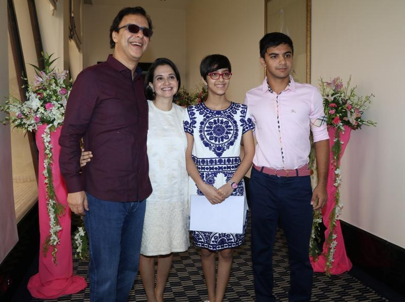 Filmmaker Vidhu Vinod Chopra with his wife Anupama Chopra, daughter Zuni Chopra and son Agni Dev during the launch of Jaslok hospital`s new wing Jaslok Fertility Tree. (IANS)