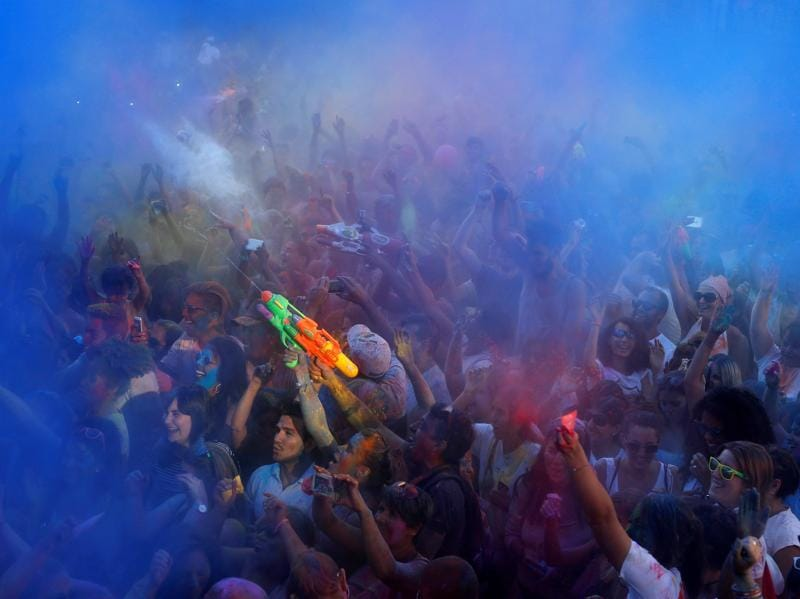 Revellers take part in the Monsoon Holi Madrid festival in Madrid, Spain, August 13, 2016. Holi in Madrid is based on the Hindu festival of the same name. (REUTERS)