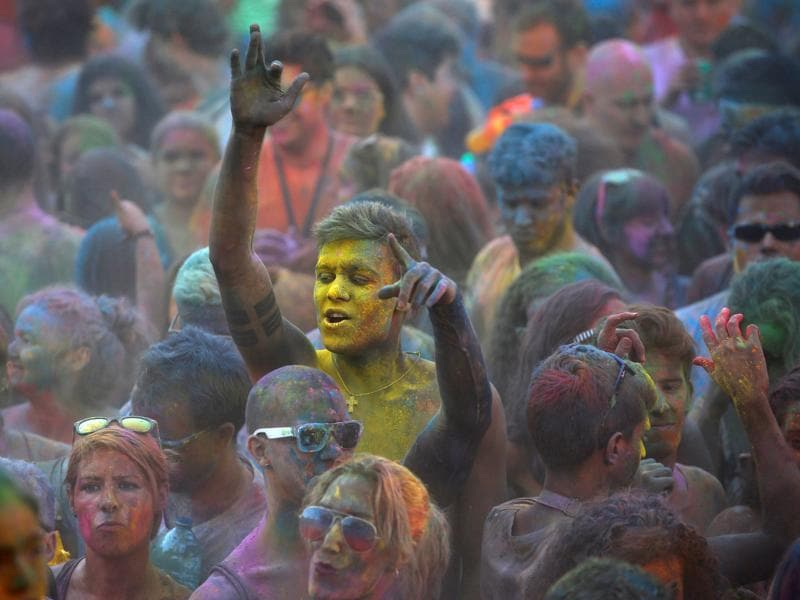 Holi has been played in India for as long as memory goes.  Revellers have a blast in Madrid.  (REUTERS)