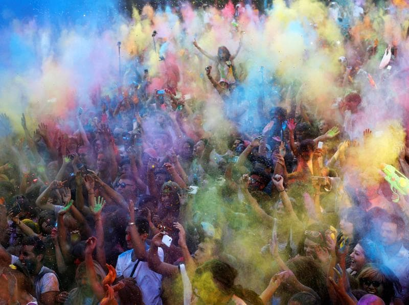 In Madrid every year, thousands dress up in white and come out to celebrate a festival of music, dance and colours. Shades of blue, green and yellow fill the air... (REUTERS)