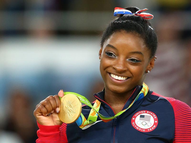 The ear-to-ear grin, which had disappeared on Monday after the beam slip, was back on show again as Biles registered her name in the history books. (Getty Images)