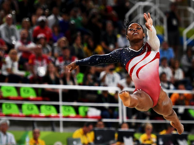 Simone Biles of the United States became the first woman in 32 years, and fifth overall, to win four golds at a single Games.  (Getty Images)