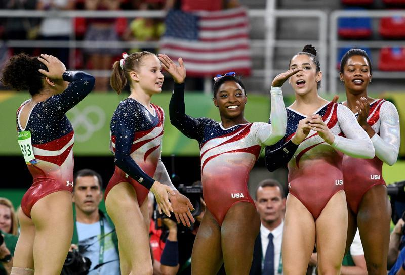 Biles kicked off the gold rush as part of the 'Final Five' - as the US women took the team all-around gold. (Getty Images)