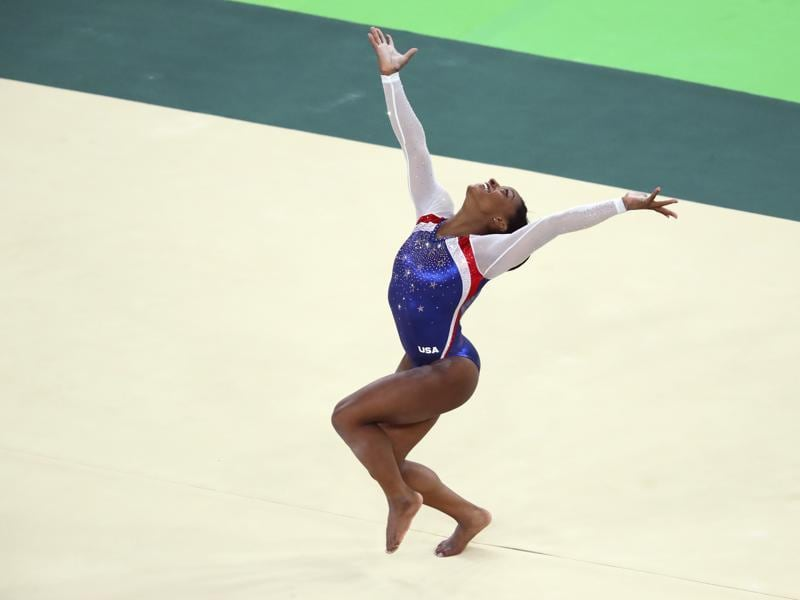 Biles then took the women's individual all-around gold; her teammate Aly Raisman took silver. (NYT)