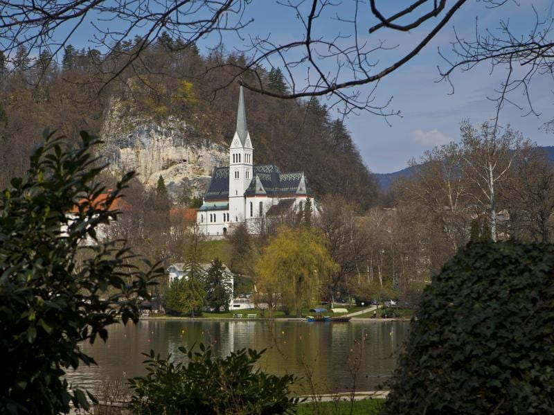 Republic of Slovenia, which was formerly a part of Yugoslavia, is a central European nation, located at the crossroads of main European cultural and trade routes. In this April 16, 2013 photo, a church is seen on the shore of Lake Bled, northern Slovenia.  (AP)