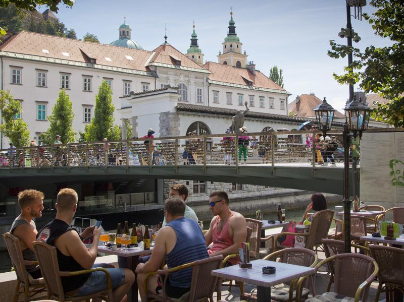 It is known for its tasty wines and food specialties such as Kranjska klobasa, a juicy pork sausage, or struklji, a traditional Slovene pastry with various fillings. In this Aug. 12, 2016 photo, a group of tourists drink beers in downtown Ljubljana. (AP)