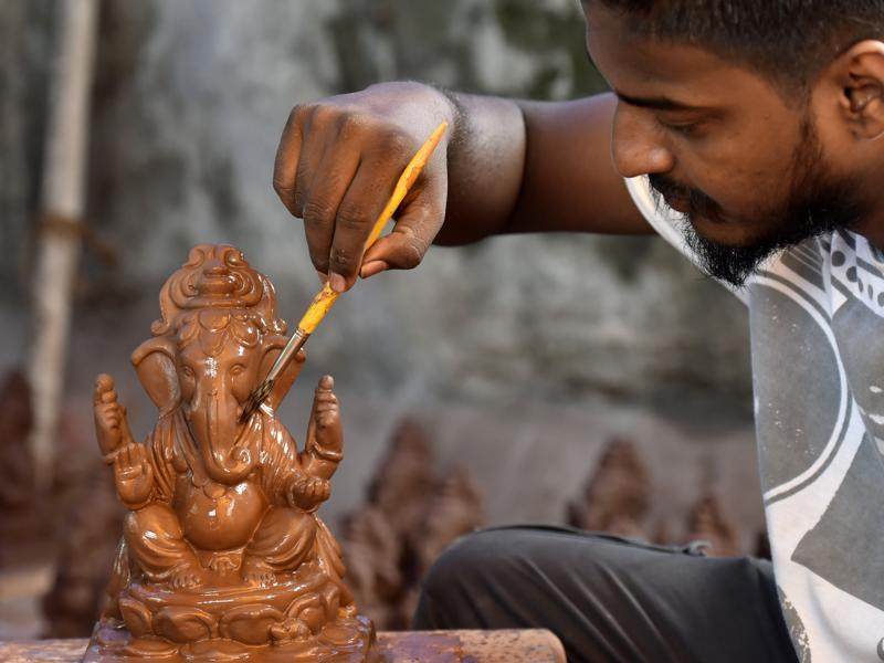 Going Green: Dattadri Kothur,30, makes an eco–friendly Ganesha (Tree Ganesha) idol at his Lower Parel workshop. (Kunal Patil)