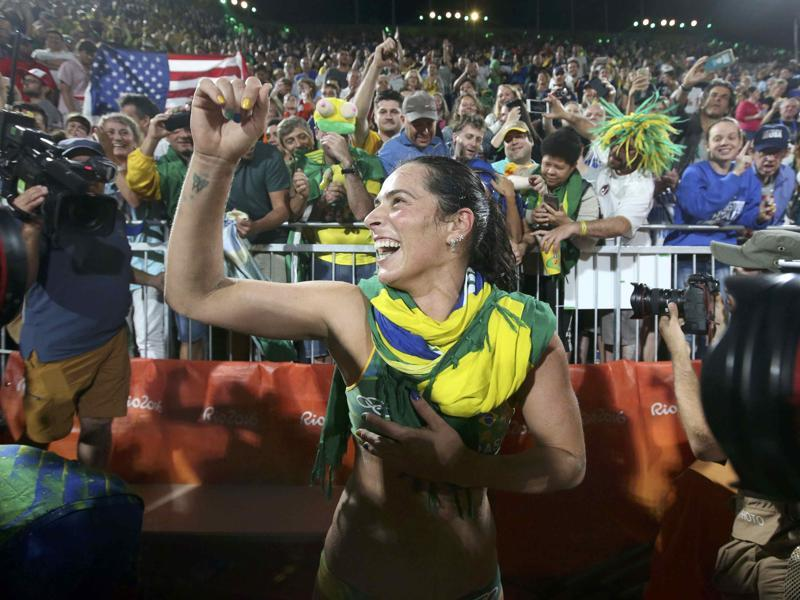 Agatha Bednarczuk of Brazil celebrates after winning the beach volleyball semifinal against the USA on Wednesday. (REUTERS)