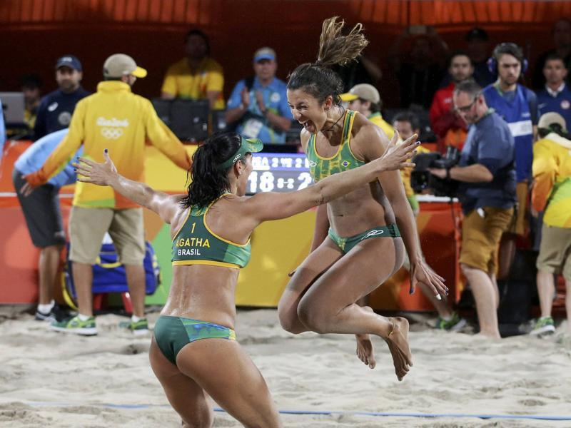 Barbara Seixas Figueiredo and Agatha Bednarczuk celebrate after winning the semifinal. (REUTERS)