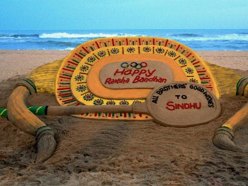 Sand sculpture created on the eve of Rakhi Purnima at Puri beach on Wednesday.  (PTI)