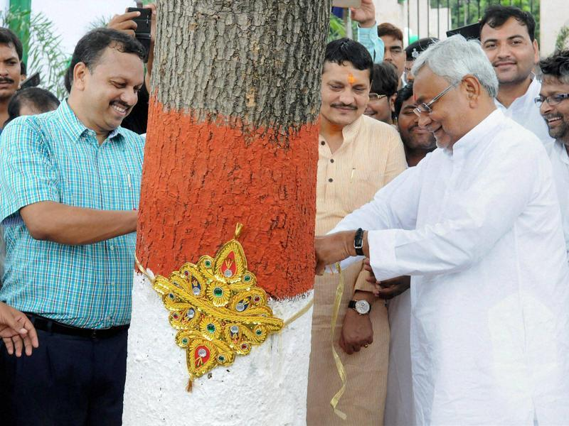 On the occasion of Rakshabandhan, Bihar chief minister Nitish Kumar tied a rakhi to a tree at Eco Park in Patna to create environmental awareness.. (PTI)
