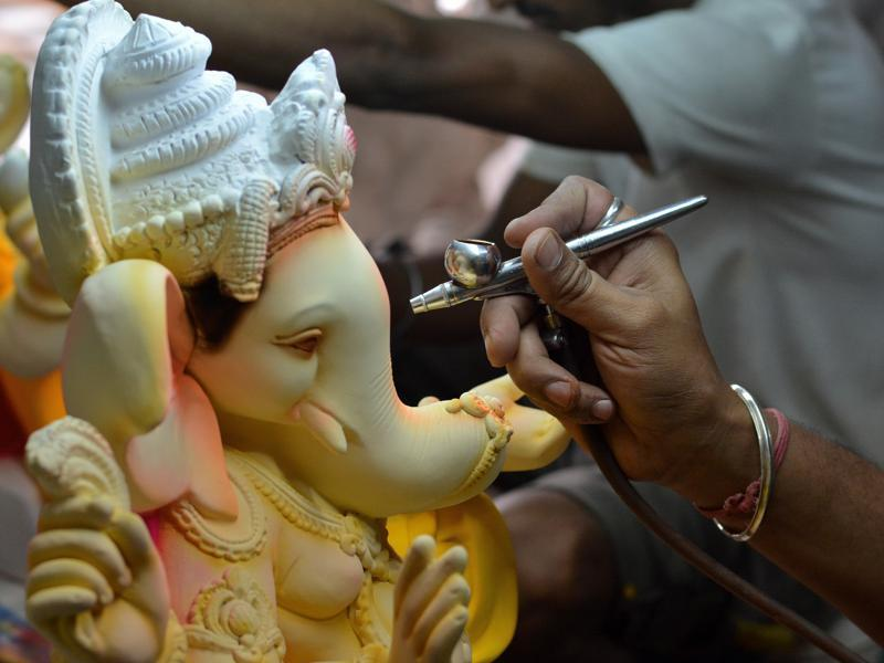 Colours of faith: An artist gives final touches to a Ganesha idol in Goregaon on Wednesday. (Prashant Waydande )