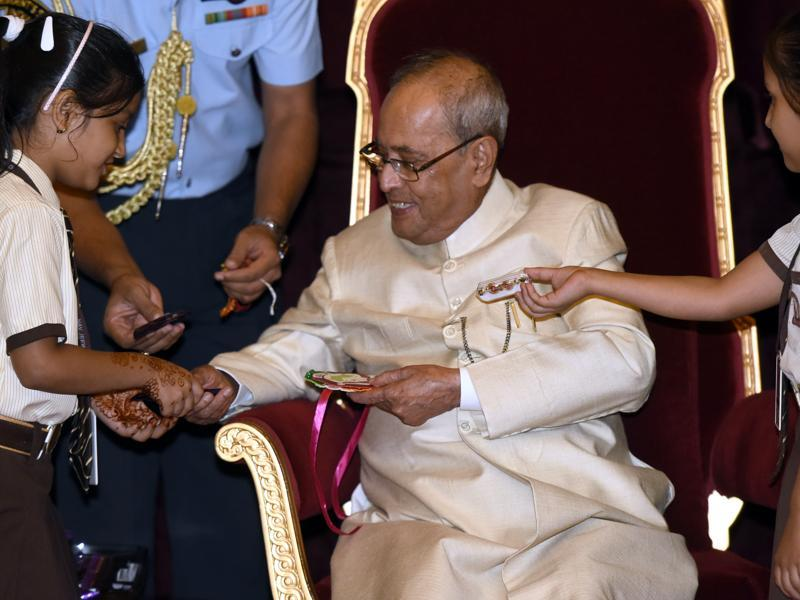 In his message to the country on the eve of Raksha Bandhan, President Pranab Mukherjee said the festival of Rakhi stands for the eternal bond of love and trust that brothers and sisters share. (Gurpreet singh/ht photo)