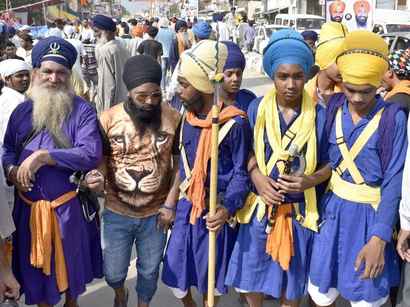 Nihang Sikhs among the crowds at the Rakhar Punia fair at Baba Bakala in Amritsar district on Thursday. (Gurpreet Singh/HT Photo)