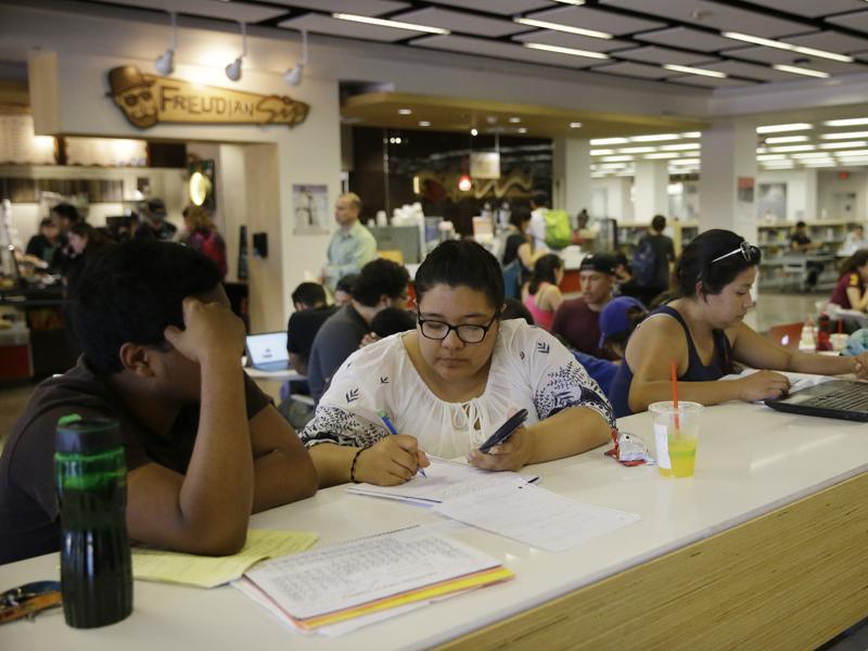 Students in the Freudian Sip Cafe inside the newly-renovated Oviatt Library on the Cal State Northridge campus in Los Angeles. The renovations opened a large informal study area on the main floor as well as group study rooms, and a music and media area.  (AP)