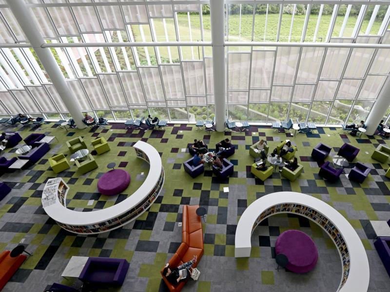 Students in the Rain Garden Reading Lounge inside the Hunt Library at North Carolina State University. The updates to the building were designed to help students learn in comfort by themselves or in groups. It offers quiet spaces and group study rooms as well as high definition video walls, 3D computing and video conferencing facilities. (AP)