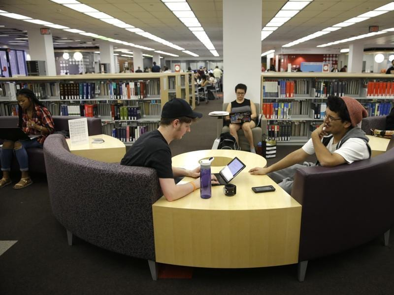 Students at the newly-renovated Oviatt Library on the Cal State Northridge campus in LA. The facility underwent a five-year renovation that included flexible learning spaces, a creative media studio, 2,500 seats for study and 190 desktops in various locations around the library.  (AP)