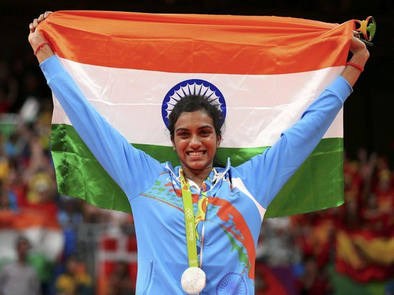 Badminton women's singles silver medallist PV Sindhu poses with the tricolour on the podium. (Marcelo del Pozo/REUTERS)