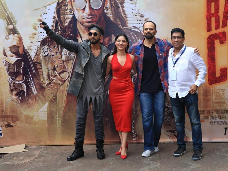 Filmmaker Rohit Shetty, actors Ranveer Singh, Tamannaah Bhatia and Ching's Secret founder Ajay Gupta pose during the premiere of the ad. (IANS)