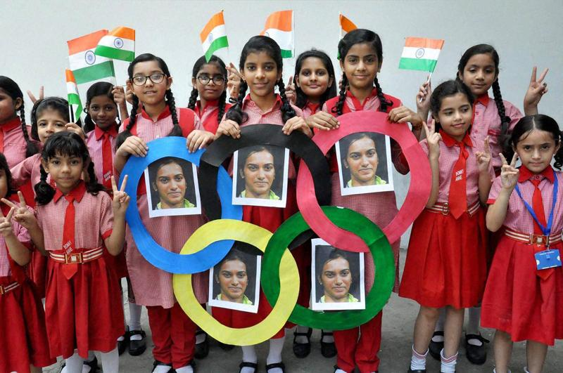 tudents in Moradabad wish shuttler PV Sindhu ahead of her final match on Friday.  (PTI Photo)