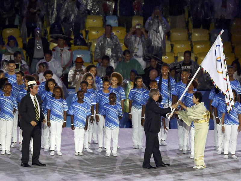 As a representative of the 2020 Olympics host city, Tokyo governor Yuriko Koike accepts the Olympic flag from International Olympic Committee (IOC) president Thomas Bach as Rio de Janeiro mayor Eduardo Paes looks on. (REUTERS)