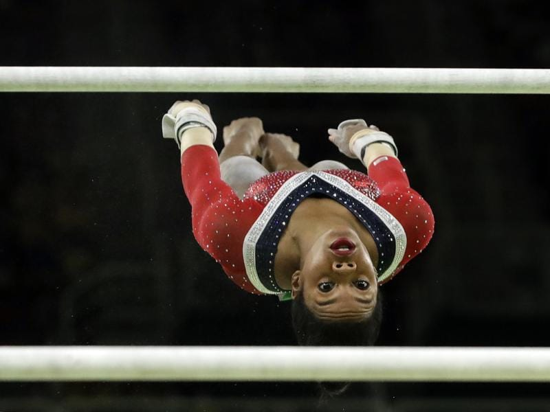 United States' Gabrielle Douglas performs on the uneven bars during the artistic gymnastics women's apparatus final at the 2016 Summer Olympics in Rio de Janeiro on August 14, 2016.  (Dmitri Lovetsky / AP Photo)