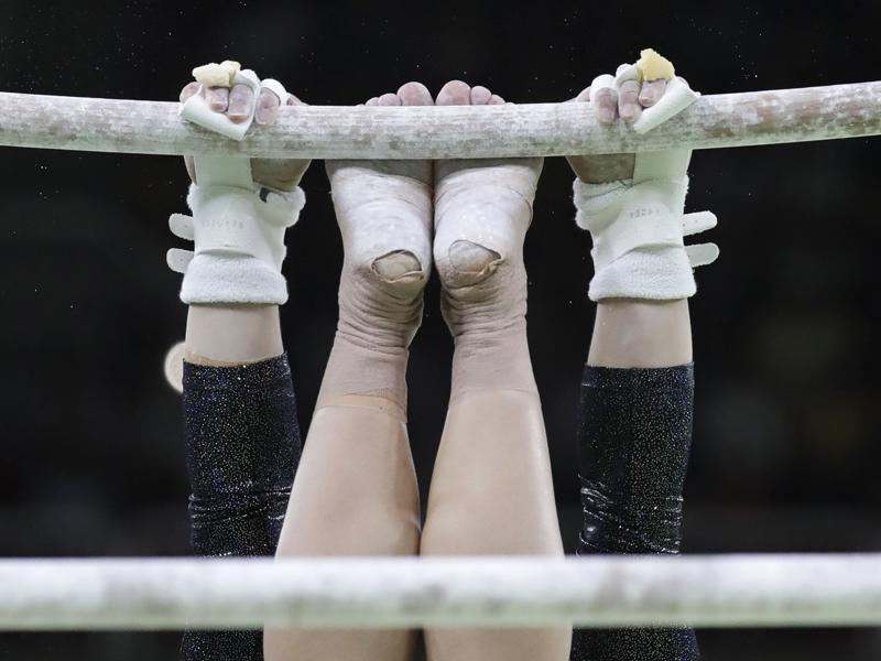Italy's Erika Fasana performs on the uneven bars during the artistic gymnastics women's qualification at the 2016 Summer Olympics in Rio de Janeiro on August 7, 2016. (Julio Cortez/AP Photo)