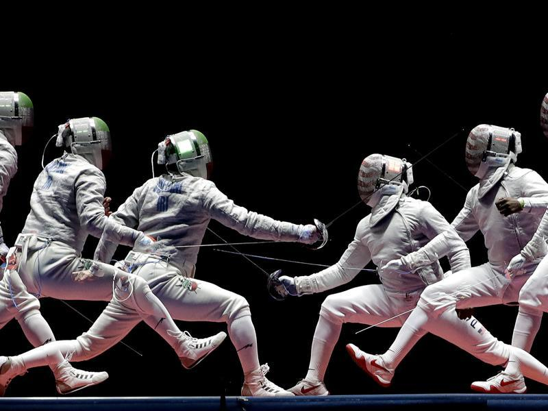 In a photo taken using multiple exposure, Iran's Mojtaba Abedini, left, and United State's Daryl Homer compete in a men's individual sabre semifinal at the 2016 Summer Olympics in Rio de Janeiro on August 10, 2016. (Charlie Riedel / AP Photo)