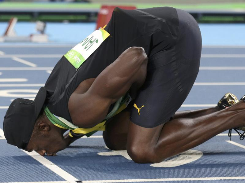 Usain Bolt kisses the track after his team won the gold. Argued to be the fastest man on the planet, the Jamaican sprinter signed off his Olympic gold rush with three medals this time. (Phil Noble/REUTERS)
