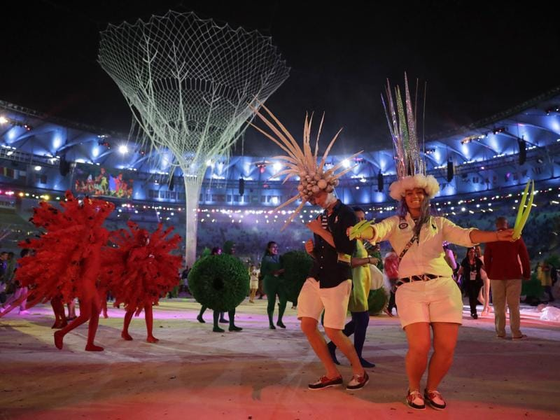 Dagmar Wozniak of the United States, right, dances with other athletes during the ceremony. (AP)