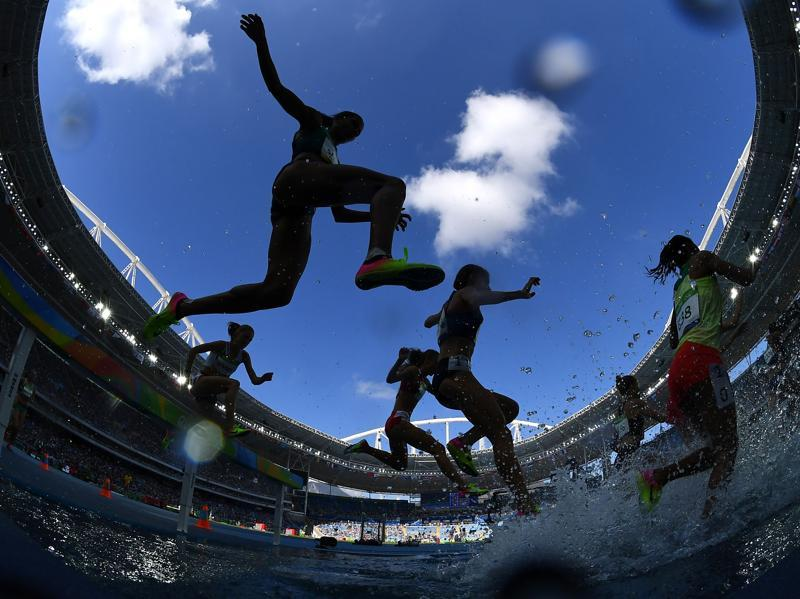 Athletes compete in the women's 3,000m steeplechase round 1 during the athletics event at the Olympic Stadium in Rio de Janeiro on August 13, 2016. (Franck Fife/ AFP Photo)