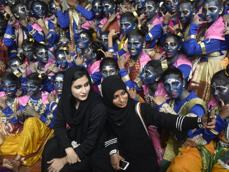 Muslim women taking selfie with college students dressed as Lord Krishna during a cultural event in the run up to the 'Dahi-Handi' (curd pot) ritual of the Janmashtami festival, at SNDT College, Matunga, Mumbai.   (Kunal Patil/HT PHOTO)
